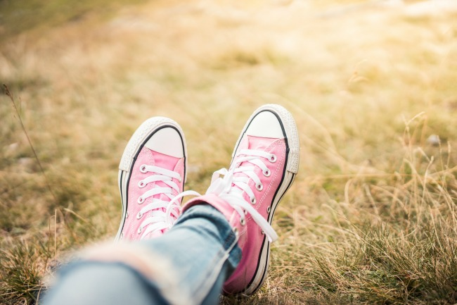 girl-with-pink-shoes-laying-in-meadow-picjumbo-com